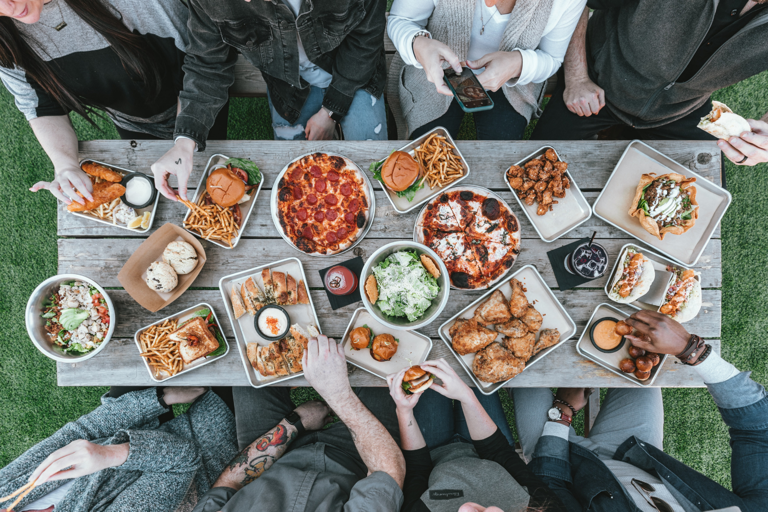 A group of people sitting around table full of plates of food; what is the gastrocolic reflex